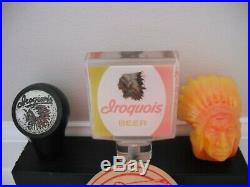 Set of iroquois, indian ball & beer tap handles with iroquois coaster & display